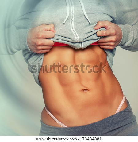 Sexy abs of a woman wearing sportswear - stock photo