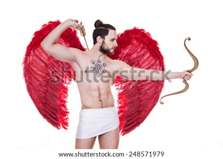 Sexy adult Cupid with big red wings. Valentine, Archangel. Studio portrait isolated over white background    - stock photo