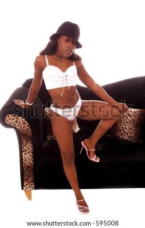 Sexy African American woman in pink lingerie and a black gangster hat