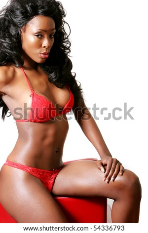 Sexy African American young woman wearing erotic red lingerie - stock photo
