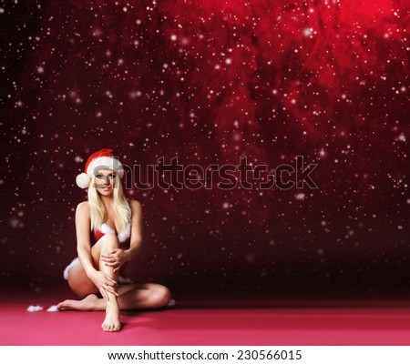 Sexy and beautiful girl. Christmas background with a snowflakes. Pin-up style. - stock photo
