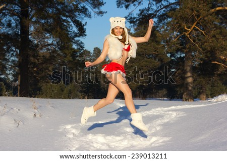 Sexy and beautiful girl in Christmas clothes over winter forest background. Christmas postcard. - stock photo
