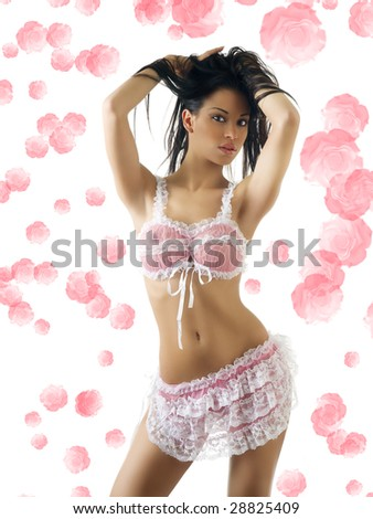 sexy and beautiful latina girl in pink lingerie keeping hair up - stock photo