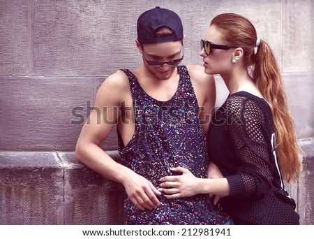 Sexy and fashionable couple wearing jeans, sunglasses. Vogue - stock photo