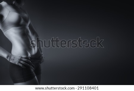 Sexy and fit woman black and white background
