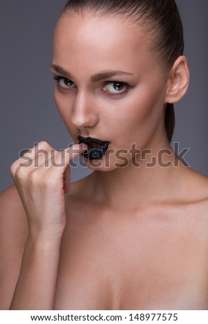 Sexy and hot closeup picture of beautiful european model. topless. finger in mouth. retouch skin - stock photo