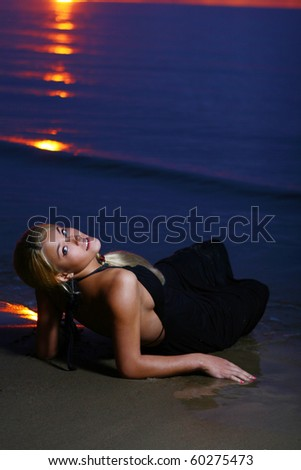 sexy and luxury woman on sunset background - stock photo