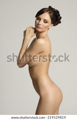 sexy and sweet portarit of a naked young woman , with stunning body , posing in tender way , natural skin
