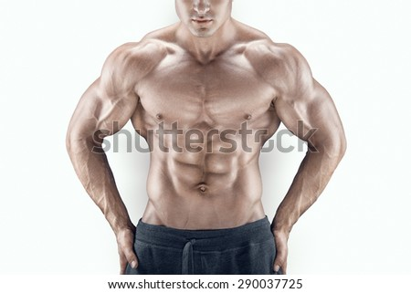 Sexy and young power athletic man with great physique. Perfect fit, six pack, abs, shoulders, deltoids, biceps, triceps and chest. - stock photo