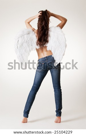 sexy angel in jeans posing against white background - stock photo
