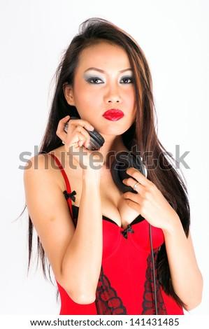 Sexy asian female dj on black background - stock photo