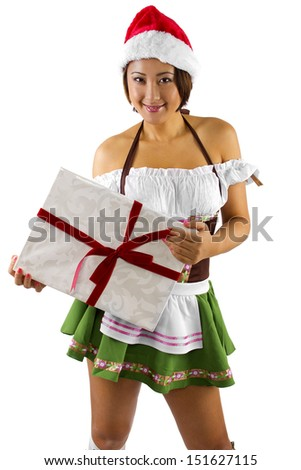 sexy asian female dressed as santa's helper elf with a gift - stock photo