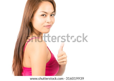 Sexy Asian female rear view wearing pink tank top back turned giving thumb up over the shoulder showing satisfaction, approval, good job, pleased - stock photo