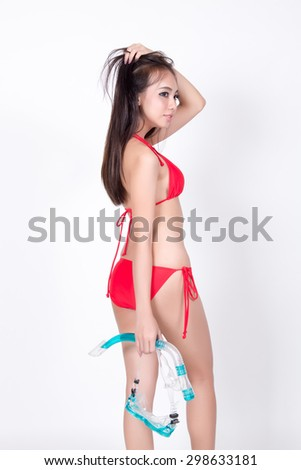 Sexy Asian girl in red bikini with snorkel, Travel concept, White Background, in studio