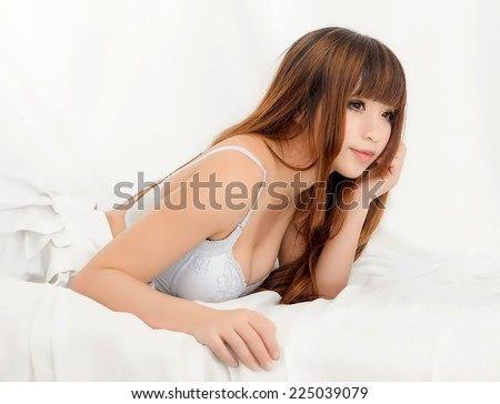 sexy asian girl model in underwear big breast thinking japanese style - stock photo