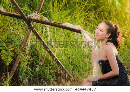 Sexy asian woman bathing in cascade at in the countryside,Rural lifestyle