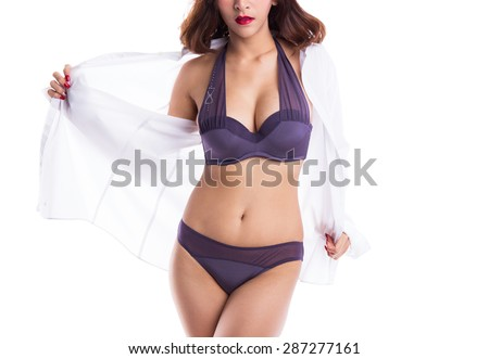Sexy asian woman showing her sexy body in purple underwear with shirt opened by hand, isolated on white background - stock photo