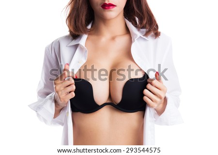 Sexy asian woman showing her sexy breast in black bra or  lingerie with shirt opened by hand on white background - stock photo
