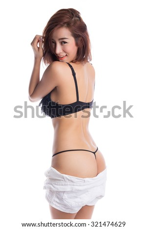 Sexy asian woman wearing black underwear and taking off her short pants,  isolated on white background - stock photo
