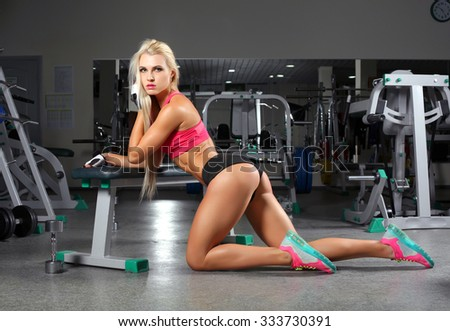 sexy athletic girl in the gym - stock photo