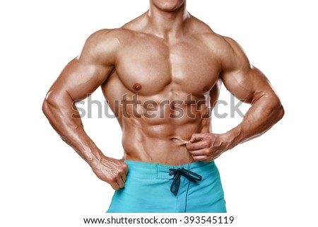 Sexy athletic man showing abdominal muscles without fat, isolated over white background. Muscular male fitness model abs - stock photo