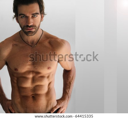 Sexy athletic shirtless man against neutral background - stock photo