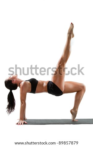 Sexy attractive woman in sports bra on yoga pose on isolated white background - stock photo