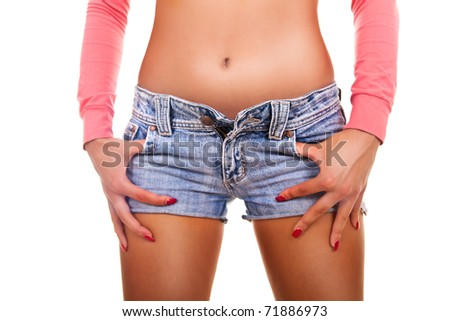 Sexy attractive  woman wearing blue jeans and handcuffs- isolated on white - stock photo