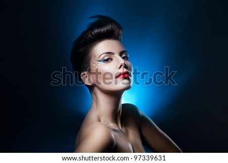 sexy attractive woman with red lips in blue light - stock photo