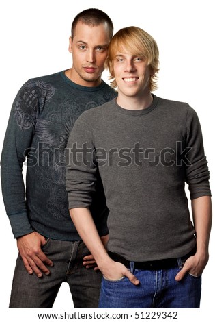 Sexy, attractive young gay couple, isolated studio image