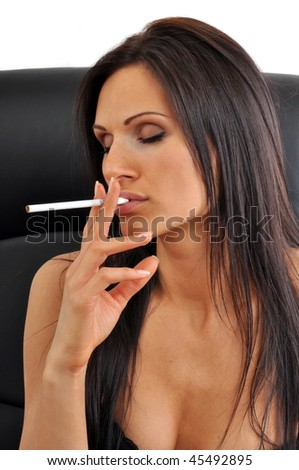 Sexy, attractive, young woman in seductive pose with cigarette - stock photo