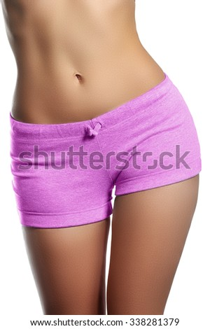 Sexy back of a beautiful woman. Beautiful woman body.Perfect shining skin for summer. Slim tanned woman's body. Isolated over white background. Beautiful sexy female slim tanned body - stock photo