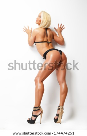 Sexy back of a blonde trained woman - stock photo