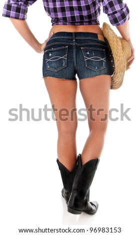 Sexy Back Side of a Cowgirl Wearing Jean Shorts, Plaid Shirt, Black Boots and Cowboy Hat - stock photo
