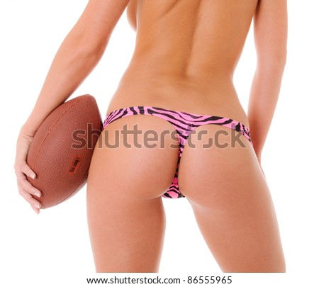Sexy Backside of a woman holding a football wearing a pink zebra print thong - stock photo