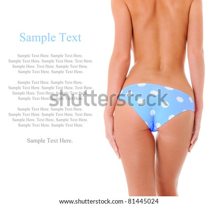 Sexy Backside of a Woman Wearing Blue Polka Dot Shorts with Text Space to the Left - stock photo