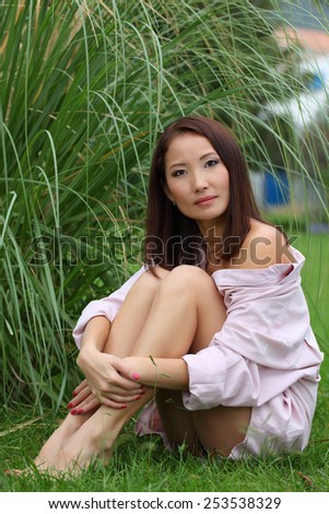 Sexy beautiful asian in the park.