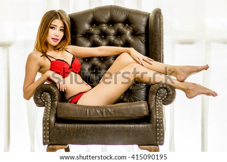 Sexy  beautiful Asian woman posing in lingerie. Girl with perfect slim body looking at camera. Studio shot. - stock photo