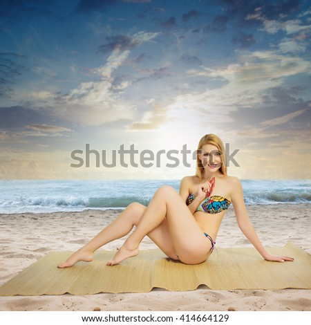 sexy beautiful blond woman on the beach