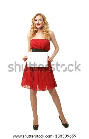 Sexy beautiful blonde girl holding blank sheet of paper - stock photo