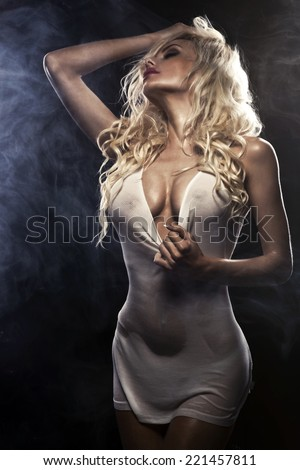 Sexy beautiful blonde woman posing in white shirt. Girl with perfect slim body.  - stock photo