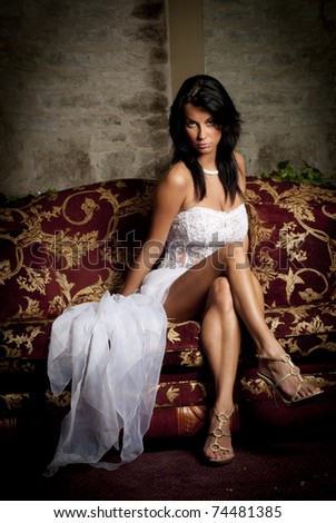 Sexy beautiful bride on a sofa
