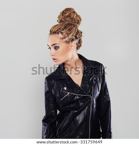 sexy beautiful girl with dreadlocks hairstyle. young woman in leather - stock photo