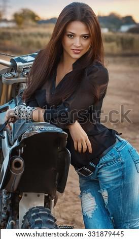Sexy beautiful girl with motorbike - stock photo