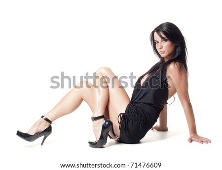 Sexy beautiful lady sitting on a floor - stock photo