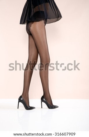 Sexy beautiful legs in pantyhose - stock photo