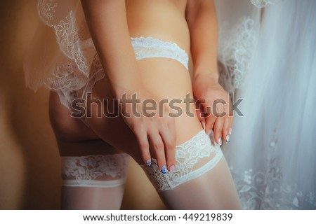 Sexy beautiful nude bride with veil in white erotic lingerie - stock photo