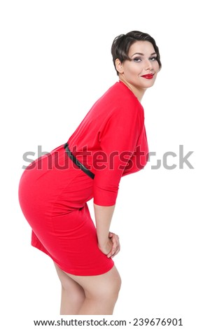 Sexy beautiful plus size woman in red dress posing  - stock photo