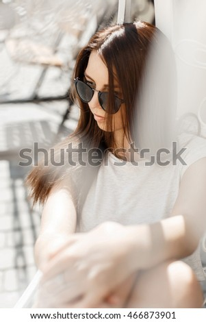 Sexy beautiful woman in fashionable sunglasses resting summer hot day.