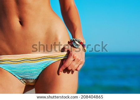 Sexy beautiful woman on sea coast - stock photo